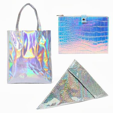 Teleportation Tote, $83.35, Ziggy Holographic Clutch, $70.24, and Sliced Clutch, $60.87. Metallic Bags at Beginning Boutique courtesy of Facebook